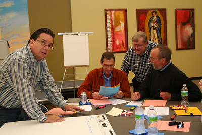 Fr. Jack Kurps reviews the previous session's work before filling out the worksheet for the afternoon session.