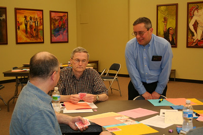 Br. Frank Presto looks on while Frs. Stephen Huffstetter and Terry Langley try their luck at cards.