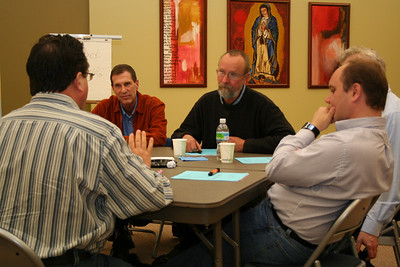 Fr. Jack Kurps talks during table discussions.