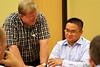 Fr. Bill Pitcavage visits Fr. Thi Pham's table.