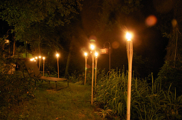 torches light up the patio at the Riverhouse