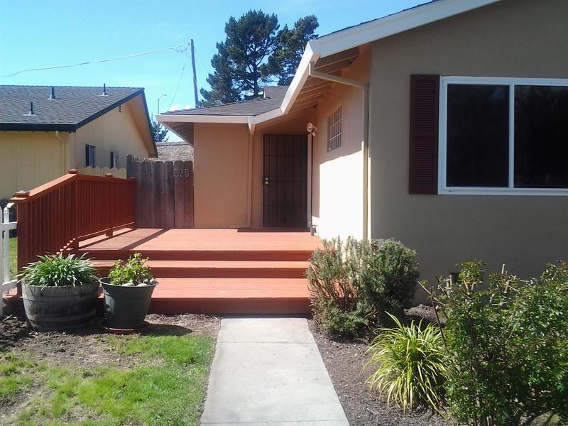 Side deck--screen door is standing open--door is to right.  Gate into back yard