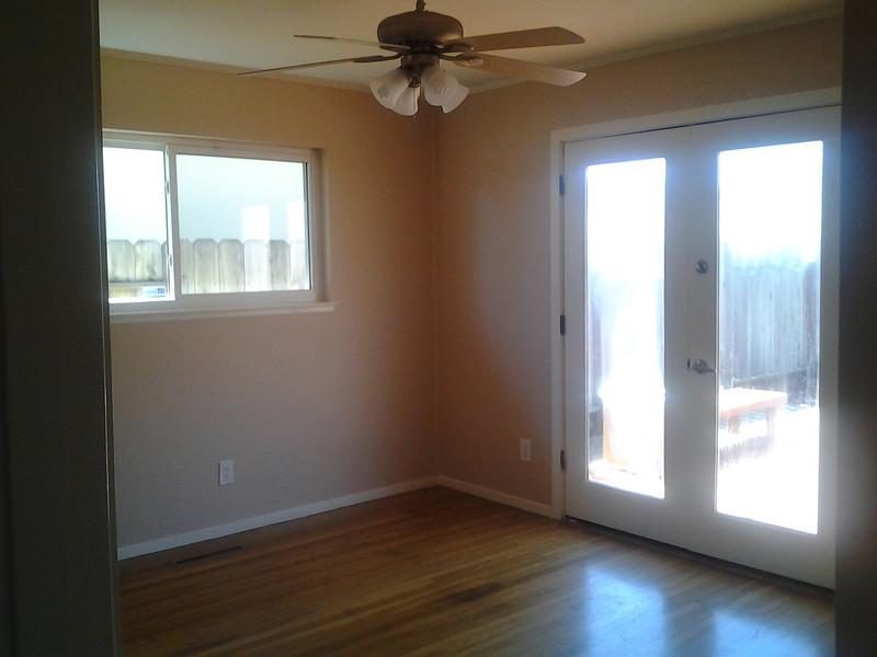 Office--doors open onto deck in back yard
