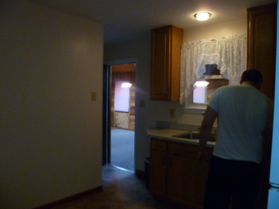 Kitchen looking into Sun Room (stairway downstairs is on the left)