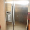 NEW stainless steel refrigerator.