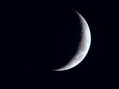 Crescent Moon taken July 10, 2005 with 6 inch f-10 Jaegers refractor telescope. Nikon 990 digital camera 1/30 second - ASA set on auto. 40 mm University Optics Kellner eyepiece, yielding 38 x.