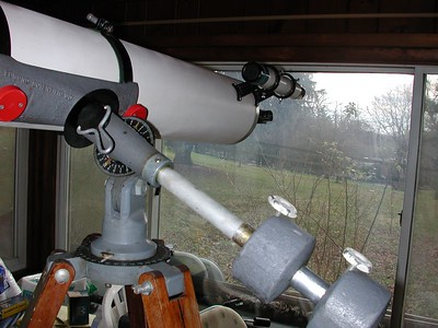 This view is of the Edmund Scientific Co Equatorial Mounting. The mount has been slightly modified to extend the Declanation axis to help off set the heavy tube assembly. This mount has factory setting circles and a base that rotates. Also of interest the hardened plastic knobs that lock the telescopes axises have inexpensive extentions that make tightening a breeze.