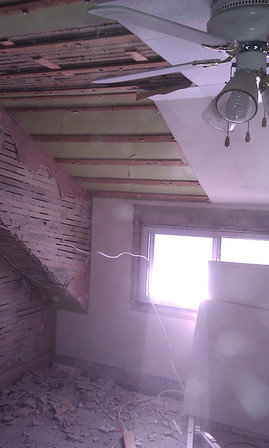 Master bedroom: SE corner, removed pasteboard to access wiring, discovered chipped away plaster on lath.
