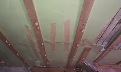 Master bedroom: ceiling. Masking tape holding plaster together.