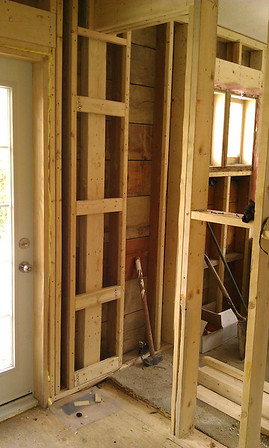 Kitchen: facing NE, framing the doorway to the dining room, door to patio at left.