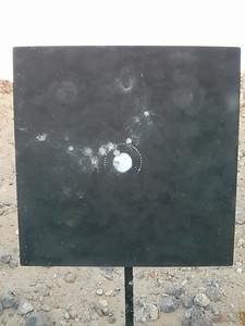 46.5 grains of BL-C(2)...  Pretty wild shooting.  88-1X.