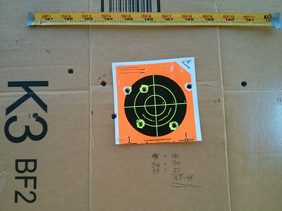 Scoring the target back at the shooting stands.  As you can see: X Ring: 4 shots - 40 points 10 Ring: 3 shots - 3 points 9 Ring: 3 shots - 27 points.  10 Shot Total: 97-4X.