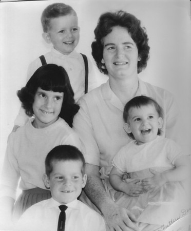 Mom with siblings before I was born.  Craig Nebeker (top), Vicky Nebeker (middle-center), Mark Nebeker (lower bottom), Lisa Nebeker Pilon (in Mom's lap) and Norma Jean Nebeker (on the right).