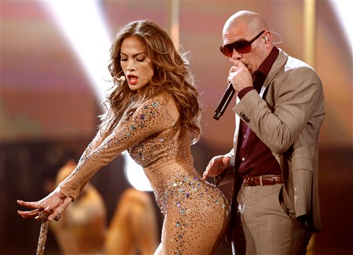 . Jennifer Lopez, left, and Pitbull perform at the 39th Annual American Music Awards on Sunday, Nov. 20, 2011 in Los Angeles. (AP Photo/Matt Sayles)