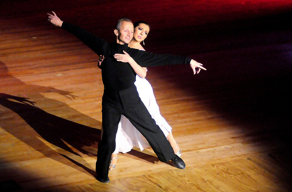 Don Knight / The Herald Bulletin<br /> Dana Stone dances the bolero with Scott Shook during the Dancing Like the Stars Benefit at the Paramount on Saturday.