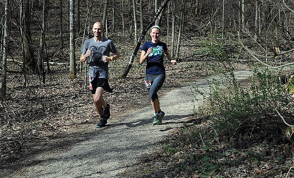 A pair of runners make their way through the woods at Seven Mile Creek Park Saturday. Photo by Pat Christman