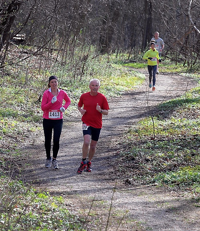 Runners weave their way through the woods Saturday. Photo by Pat Christman