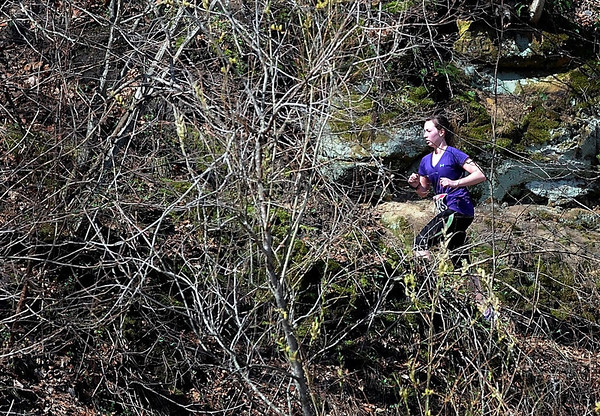 Casey Land of North Mankato climbs a hill near the finish line of the 7@7 Trail Race Saturday at Seven Mile Creek Park.  Photo by Pat Christman