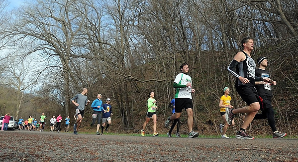 Runners leave the start line during Saturday's 7@7 Trail Race at Seven Mile Creek Park. Photo by Pat Christman