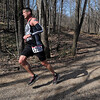 7@7 Trail Race runner Kevin Langton of Mankato rounds a bend during the race Saturday. Photo by Pat Christman