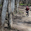 Keith Rudolph of Eagan winds through the woods during the 7@7 Trail Race Saturday. Photo by Pat Christman
