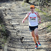 7@7 Trail Race winner Thomas Myers makes his way down a hill Saturday at Seven Mile Creek Park. Photo by Pat Christman