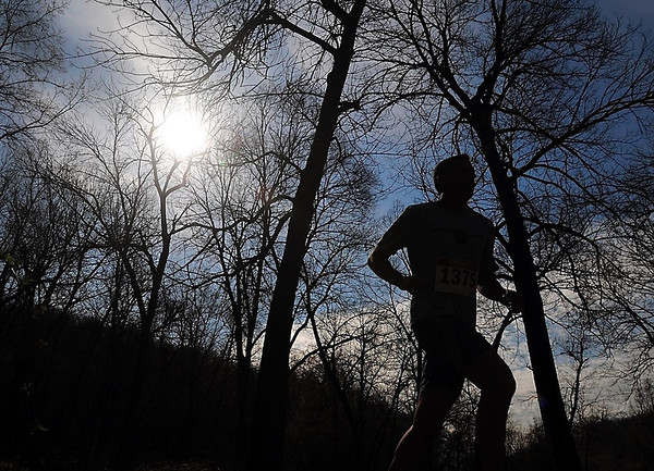 A runner enjoys blue skies during Saturday's 7@7 Trail Race. Photo by Pat Christman