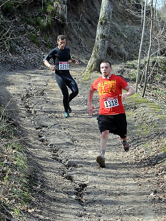 Runners Jake Carroll, front, and Justin Carroll make their way down a hill during Saturday's 7@7 Trail Race. Photo by Pat Christman