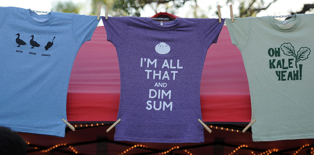 . A few of the different t-shirts for sale during the 626 Night Market at Santa Anita Park in Arcadia, Calif., on Saturday, Aug. 16, 2014.  (Photo by Keith Birmingham/ Pasadena Star-News)