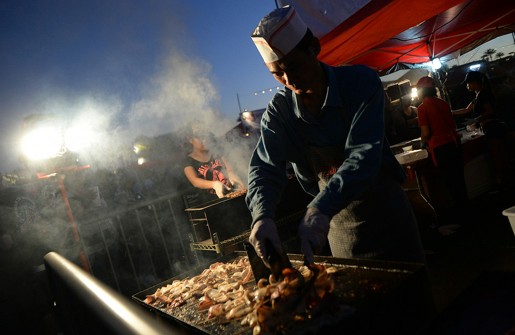 . Squid cooking under the lights during the 626 Night Market at Santa Anita Park in Arcadia, Calif., on Saturday, Aug. 16, 2014.  (Photo by Keith Birmingham/ Pasadena Star-News)