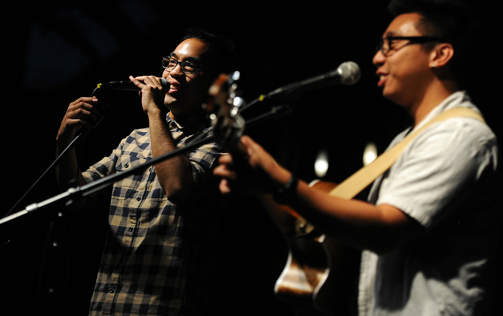. Music artist\'s Christopher Arron, left, and Sonny V perform during the 626 Night Market at Santa Anita Park in Arcadia, Calif., on Saturday, Aug. 16, 2014.  (Photo by Keith Birmingham/ Pasadena Star-News)