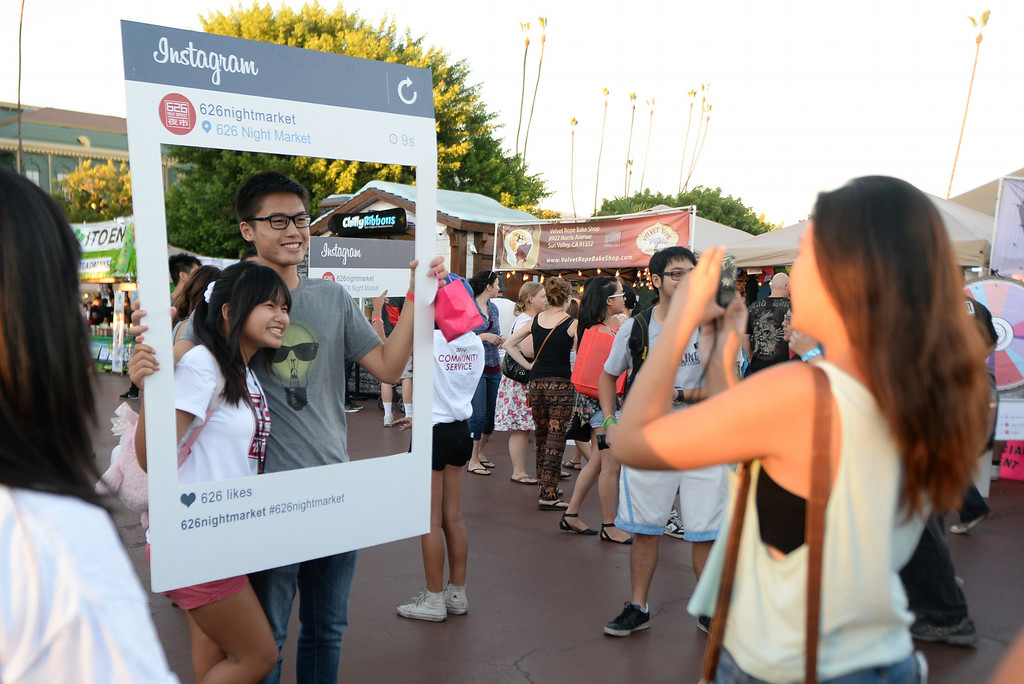 . Kevin Huo, right, of Rowland Heights along with Mikayla Saykahm of West covina pose for a picture during the 626 Night Market at Santa Anita Park in Arcadia, Calif., on Saturday, Aug. 16, 2014.  (Photo by Keith Birmingham/ Pasadena Star-News)