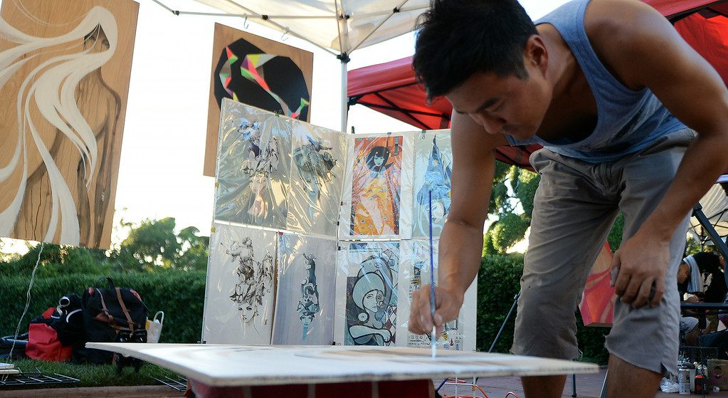 . Artist Eddie Lee of Los Angeles paints during the 626 Night Market at Santa Anita Park in Arcadia, Calif., on Saturday, Aug. 16, 2014.  (Photo by Keith Birmingham/ Pasadena Star-News)