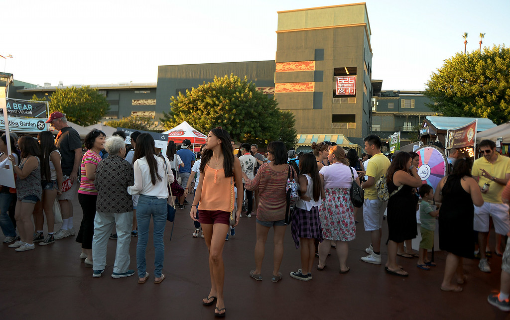. Thousands eat, shop and listen to music during the 626 Night Market at Santa Anita Park in Arcadia, Calif., on Saturday, Aug. 16, 2014.  (Photo by Keith Birmingham/ Pasadena Star-News)