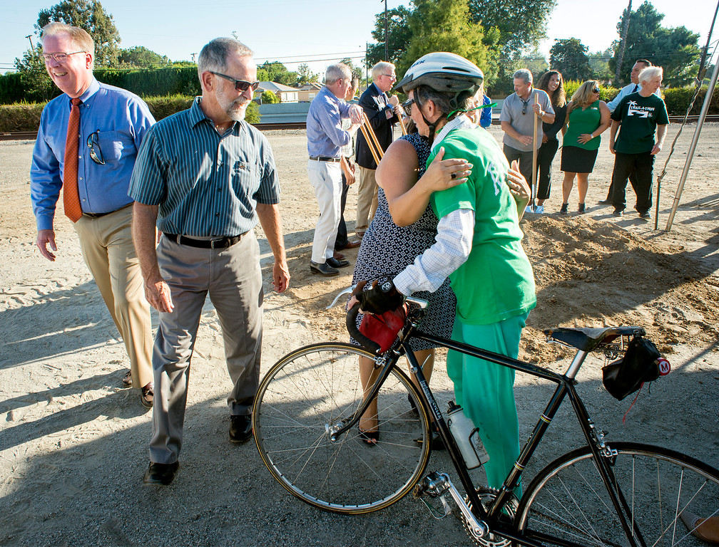 . Congress member Linda Sanchez hugs Whittier Wheelmen president Sam Guyan, with bicycle, during a ground-breaking ceremony for the 2.8-mile Greenway Trail east expansion August 16, 2016.  A parking lot is planned parking that will serve as a rest spot for trail users, including bicycle racks, seating, drinking fountains, security lighting and signage.   (Photo by Leo Jarzomb/Whittier Daily News)