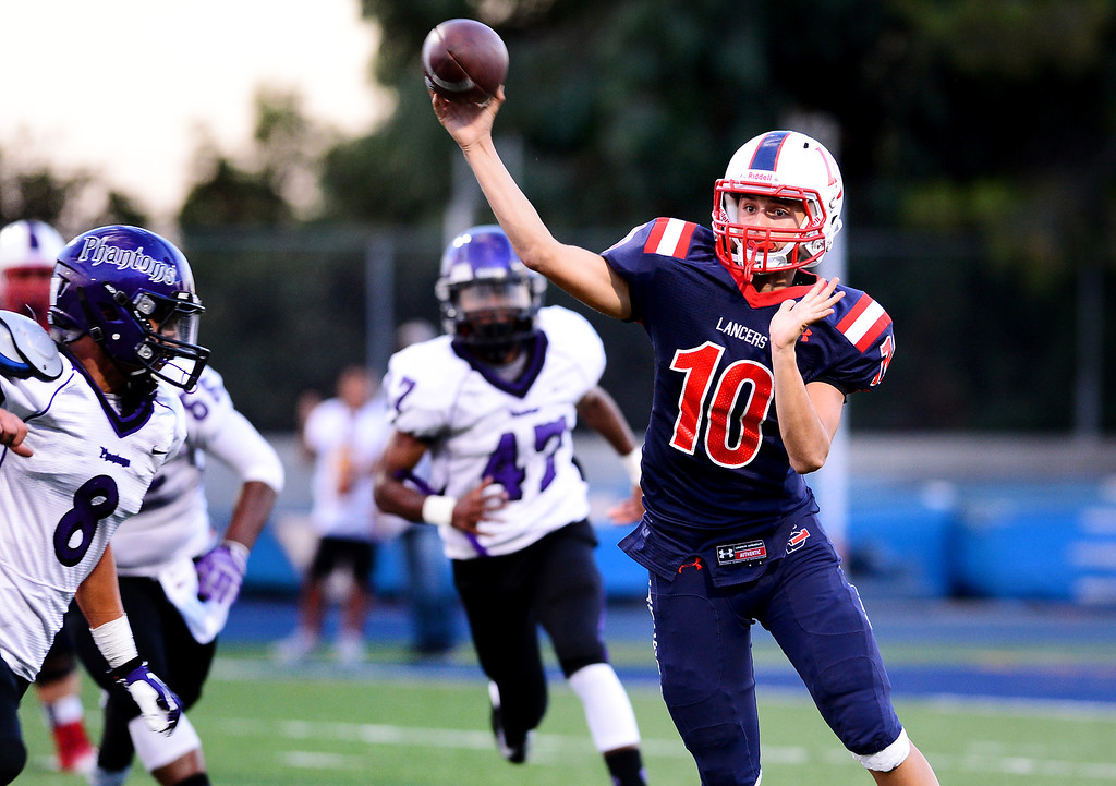. La Salle\'s quarterback Aaron McCorkle goes for a pass during the first half of Friday night\'s game against  Cathedral at La Salle High School in Pasadena, on August 30, 2013. (Photo by Sarah Reingewirtz/Pasadena Star-News)