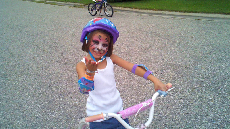 8/14/11 Madeline riding her bike without training wheels