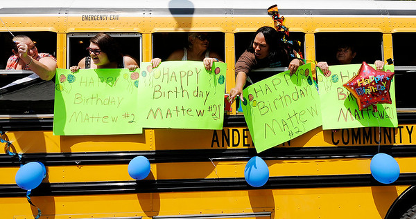 Don Knight | The Herald Bulletin<br /> A school bus is decorated for Matthew Robinette's 21st birthday during a parade for Robinette on Saturday.