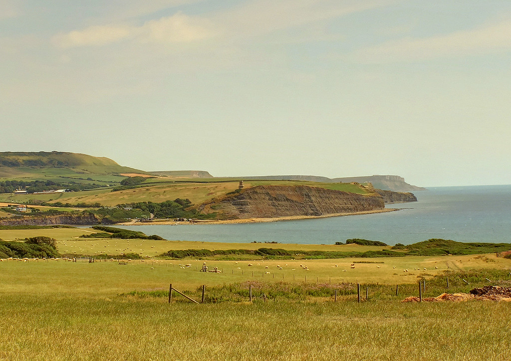 Kimmeridge Bay.   The building on the cliff edge in the centre is Clavell Tower, recently moved back from the cliff edge due to erosion.