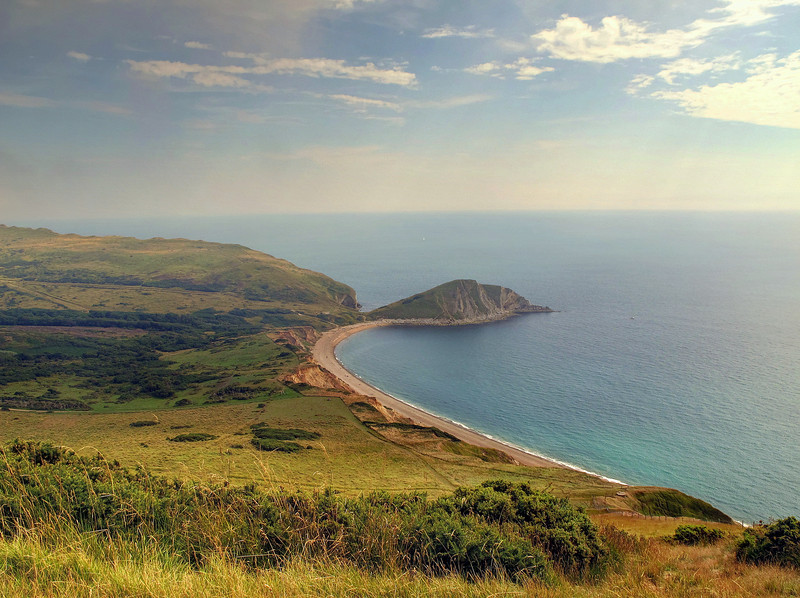 The view down to Warbarrow Bay from Flowers Barrow, an iron age hill fort now partly lost to erosion over the millennia.