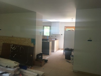 From front door shows 2 walls to remove