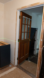 Looking at door to mudroom, elevation change and concreate floor out there.