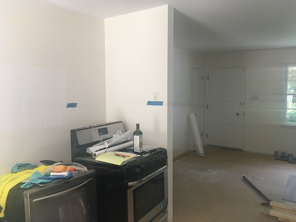 looking from dining to front door. Shows smaller of 2 walls to be removed