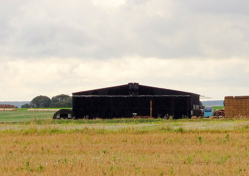 Tarrant Rushton<br /> <br /> There are still hangars at this old airfield, now used as barns by local farmers.