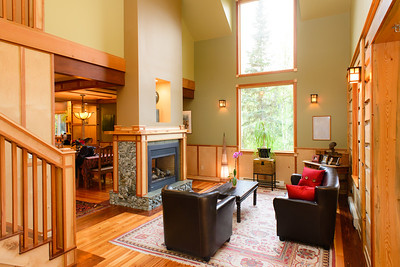 Living room. Wood accents are a combination of birch and fir. Wherever possible wood used in the house comes from local sources including trees harvested from the property, Red Rock and McBride.