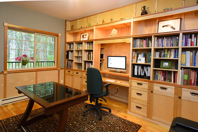 A large office off of the main entrance. Extensive custom built ins, perfect for the professional.