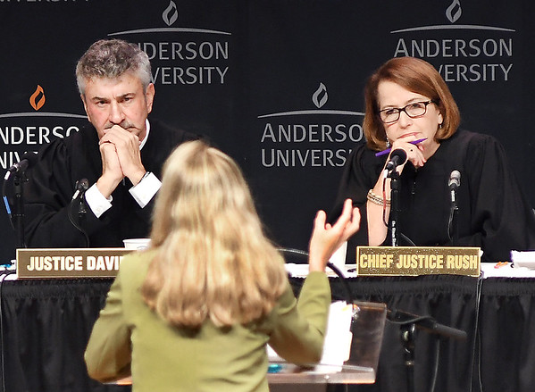 John P. Cleary | The Herald Bulletin<br /> Indiana Supreme Court Justice Steven David, and Chief Justice Loretta Rush listen intently as Leanna Weissmann makes her point during oral arguments in front of the court in the case of Marcus Zanders v. State of Indiana held at Anderson University's Reardon Auditorium Wednesday.