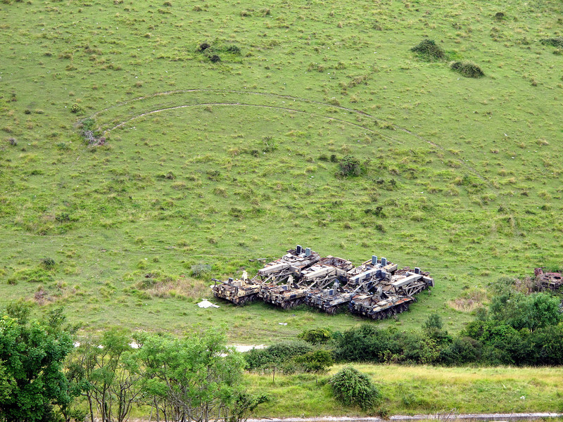 Target vehicles parked under the hill.