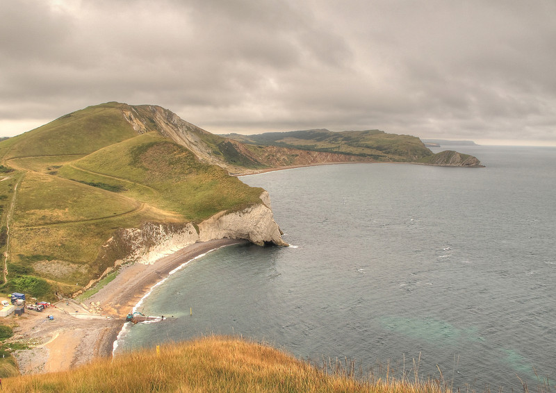 A lull in the pulses of rain reveals the coast as far as St Aldhelm's Head.