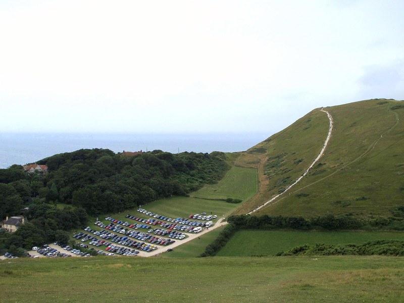 The carpark at Lulworth Cove and the path over Hambury Tout towards Durdle Door.
